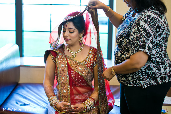 getting ready,hair and makeup,gold bridal set,bridal lengha
