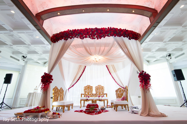 ceremony,ceremony decor,indian wedding ceremony,indian wedding,mandap,indoor mandap,venue,wedding venue,chairs,floral and decor,flowers