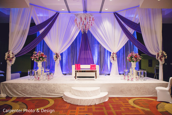 reception decor,sweetheart stage,floral arrangements,indian wedding reception