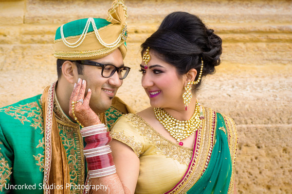 first look,first look portraits,bridal fashion,bridal sari,sherwani,groom fashion,hair and makeup,outdoor portraits,portraits,gold bridal set,gold jewelry,tikka,gold necklace,necklace,bangles,earrings,gold earrings,hair