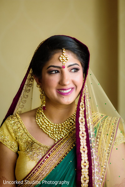 getting ready,hair and makeup,bridal jewelry,gold bridal set,gold necklace,necklace,tikka,ruby