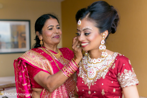 indian bride getting ready,indian bridal jewelry,indian weddings,indian bridal hair and makeup