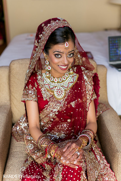 indian bride getting ready,indian bridal jewelry,indian weddings,indian bridal hair and makeup,indian bridal lengha,indian wedding lengha,indian sari