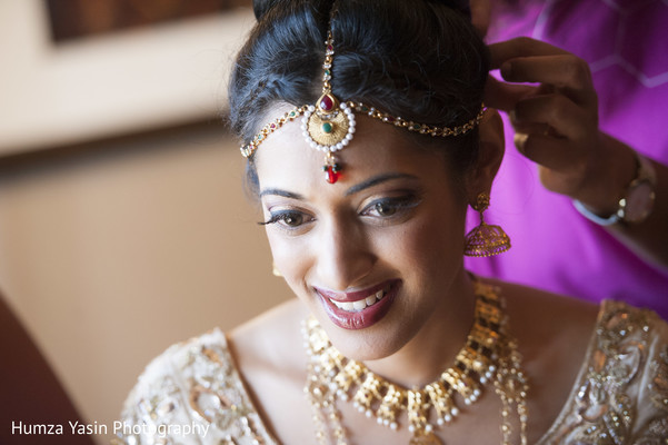 getting ready,bridal jewelry,gold bridal set,tikka,hair and makeup