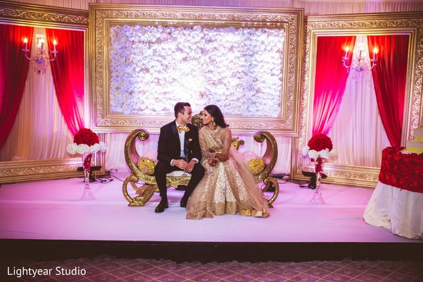 indian wedding reception,reception,reception decor,sweetheart stage,floral and decor,reception fashion,lengha,suit