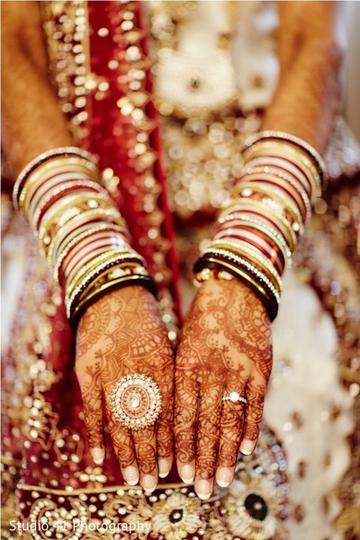 indian bride getting ready,indian bridal jewelry,indian wedding mehndi,indian wedding bangles