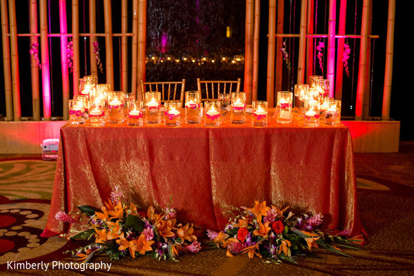 indian wedding reception,reception,reception decor,floral and decor,candles,floral arrangements,sweetheart table