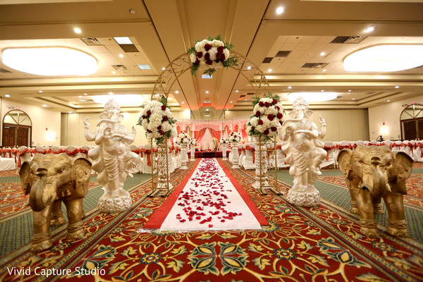 indian wedding ceremony,indian wedding,indian ceremony,ceremony,ceremony decor,mandap,venue,ceremony venue,floral and decor,aisle,aisle decor,elephant statues