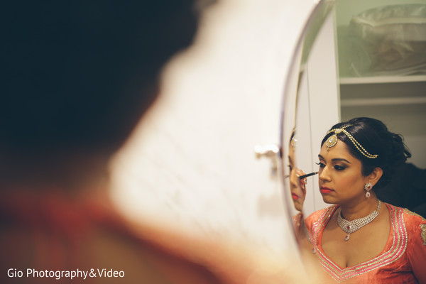 indian bride getting ready,indian bridal hair and makeup,ikka