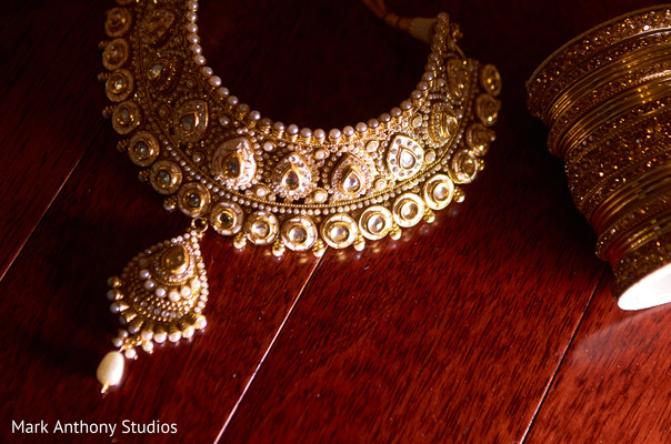 indian bride getting ready,indian weddings,gold indian wedding jewelry,indian bridal jewelry