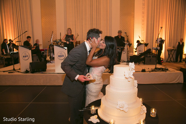 Cutting the Cake in Chicago, IL Fusion Wedding Wedding by Studio Starling