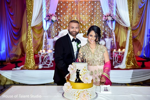 Cutting the cake in Princeton, NJ Indian Wedding by House of Talent Studio