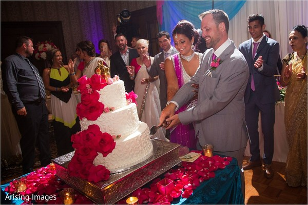 Cake cutting in Grand Blanc, MI Indian Fusion Wedding by Arising Images