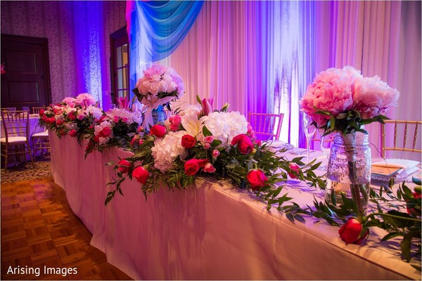 Reception floral and decor in Grand Blanc, MI Indian Fusion Wedding by Arising Images