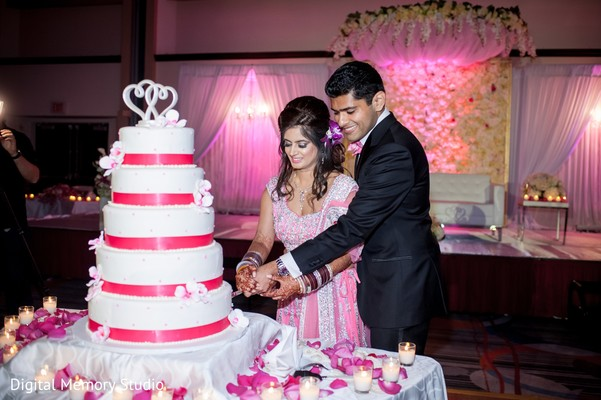 Cake cutting in Huntington, NY Indian Wedding by Digital Memory Studio