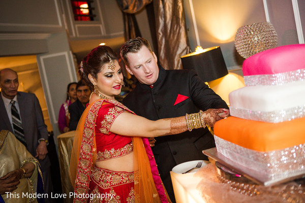 Cutting the cake in Atlanta, GA Indian Fusion Wedding by This Modern Love Photography