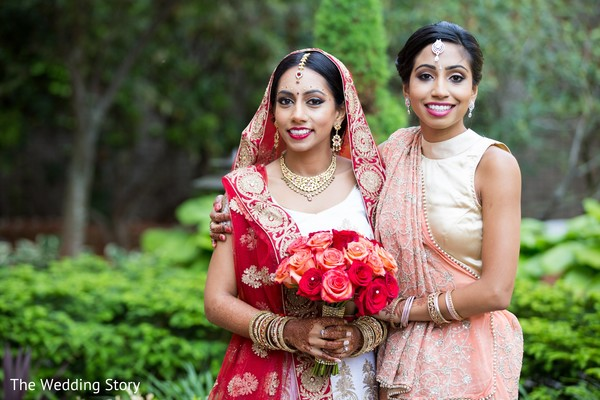 Bride and bridesmaid in Cambridge, MA Indian Wedding by The Wedding Story
