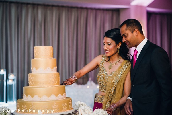Cutting the cake in Springfield, PA South Asian Wedding by Charmi Pena Photography