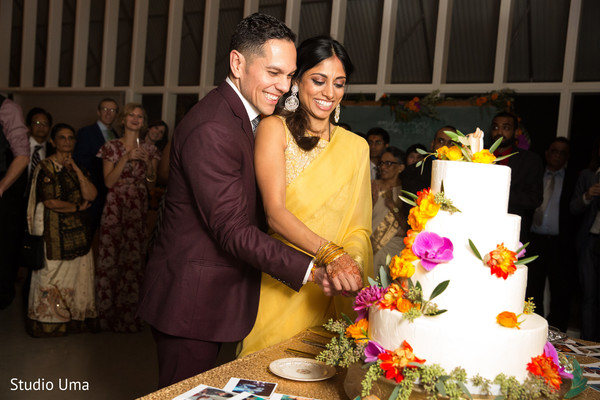 cake cutting,cutting the cake,reception photography,indian bride and groom reception,indian reception pictures,indian reception photography,indian bride and groom reception photography,reception photos,indian wedding reception,indian wedding reception photos,indian wedding reception pictures,indian wedding reception photography,wedding reception,reception,indian wedding cake,indian wedding cakes,wedding cake,wedding cakes