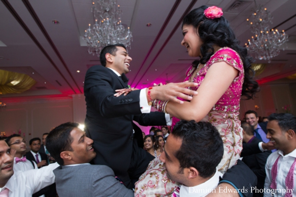 bride,and,groom,dancing,Damion,Edwards,Photography,dancing,at,the,indian,wedding,reception,indian,wedding,reception,traditional,dancing,customs