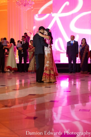 bride,and,groom,dance,at,reception,Damion,Edwards,Photography,dance,floor,lighting,at,reception,indian,wedding,reception,lighting,lighting,at,wedding,reception,wedding,lighting,ideas