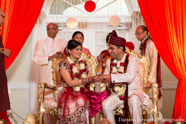 bride,and,groom,at,wedding,ceremony,ceremony,Damion,Edwards,Photography,indian,bride,and,groom,jai,mala,traditional,customs,and,rituals,at,the,indian,wedding,traditional,indian,wedding,ceremony