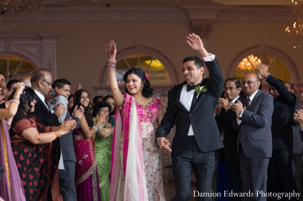 bride,and,groom,enter,wedding,reception,Damion,Edwards,Photography,indian,wedding,couple,wedding,reception,celebration