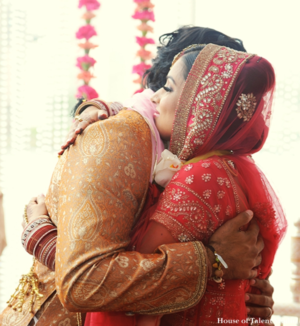 Ceremony,indian-wedding-bride-groom-embrace-red