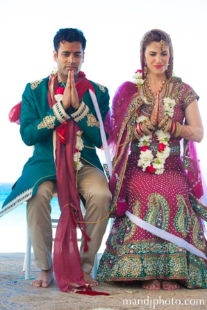 bride,and,groom,at,cremony,ceremony,indian,wedding,couple,jai,malas,M,&,J,Photography,outdoor,wedding,ceremony,traditional,rituals,and,customs