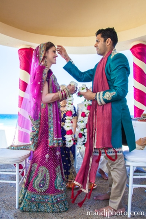 beach,weddings,bride,and,groom,at,wedding,ceremony,fusion,indian,wedding,indian,wedding,ceremony,indian,wedding,couple,M,&,J,Photography