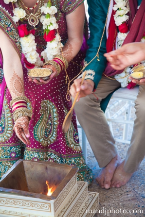 beach,weddings,bride,and,groom,at,wedding,ceremony,ceremonial,rituals,and,customs,ceremony,traditions,fusion,indian,wedding,indian,wedding,ceremony,indian,wedding,couple,M,&,J,Photography