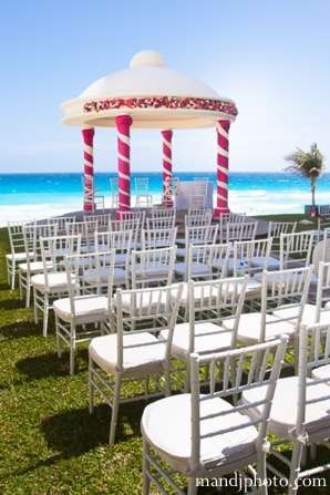 beach,weddings,indian,wedding,ceremony,decor,indian,weddings,at,beach,resorts,M,&,J,Photography,mandap,and,chairs,at,ceremony,Planning,&,Design,white,chairs