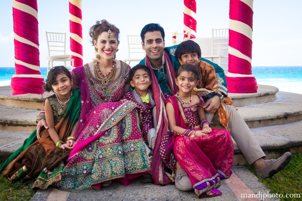 beach,weddings,bride,groom,and,kids,at,wedding,ceremony,portrait,destination,weddin,indian,beach,weddings,indian,wedding,portrait,indian,weddings,M,&,J,Photography,portraits,traditional,portraits