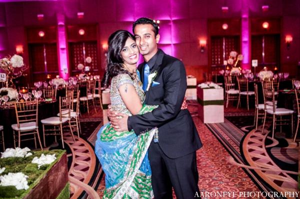 Indian wedding reception bride groom lighting venue decor