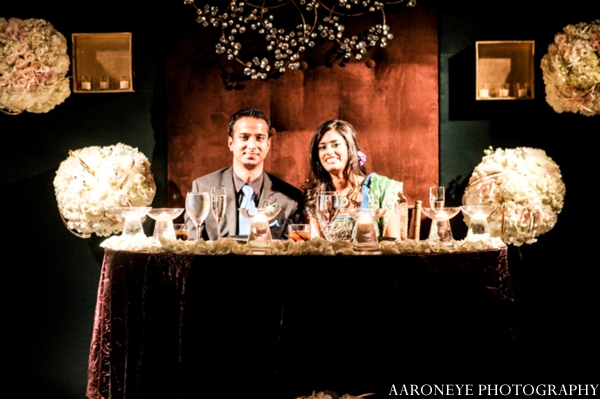 Indian wedding reception bride groom sweetheart table