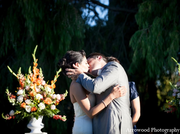Indian wedding outdoor floral kiss in Adorable Indian Fusion Wedding by Arrowood Photography Burlingame, California