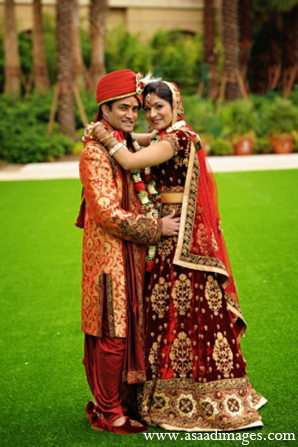 red,gold,portraits,indian bride and groom,indian bride groom,photos of brides and grooms,images of brides and grooms,indian bride grooms,indian wedding outfits,indian wedding outfits for brides,Asaad Images