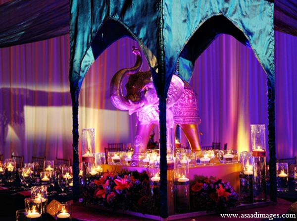 Indian wedding reception decor lighting purple in Orlando, Florida Indian Wedding by Asaad Images