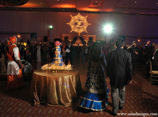 Indian wedding reception lighting cake in Orlando, Florida Indian Wedding by Asaad Images