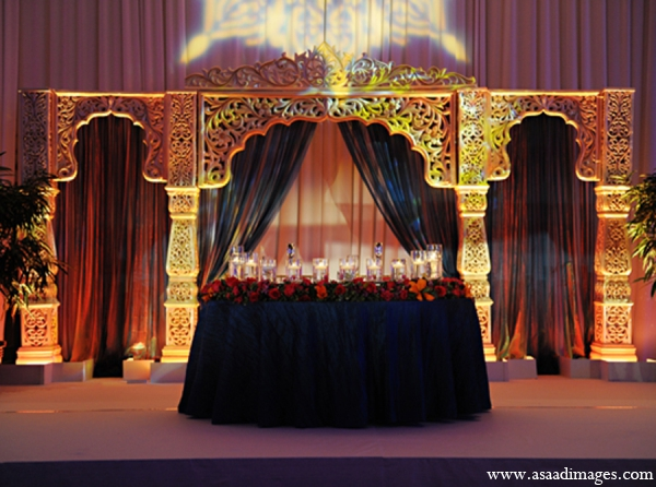 Indian wedding reception lighting decor in Orlando, Florida Indian Wedding by Asaad Images