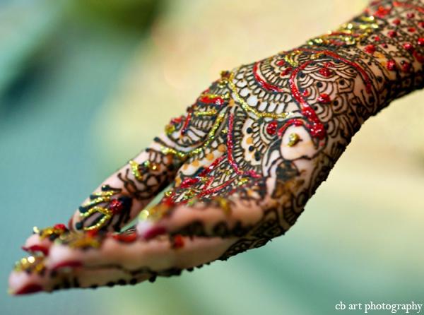 Indian wedding mehndi gold red