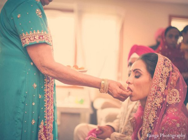 Indian wedding doli bride veil in Glen Rock, NJ Indian Wedding by Banga Photography