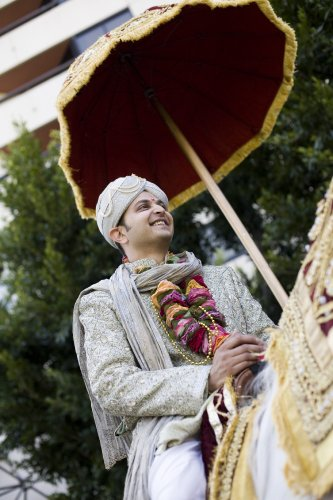 Indian-wedding-baraat-white-horse-groom-fusion-maroon-umbrella-gold-1