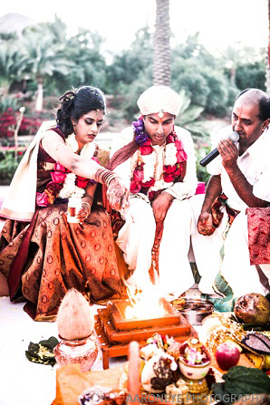 Traditional fire ceremony under the mandap.