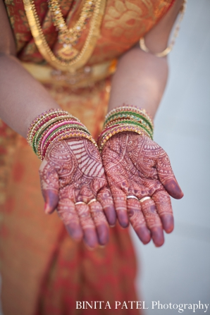 orange,Mehndi Artists,indian wedding mehndi,indian bridal henna,henna on hands,BINITA PATEL Photography,bridal inspiration for henna