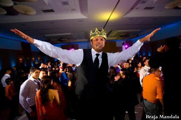 Indian wedding groom dancing reception in San Diego, California Indian Wedding by Braja Mandala Wedding Photography