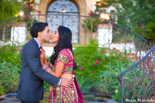 Indian-wedding-couple-portrait-groom-bride-kissing