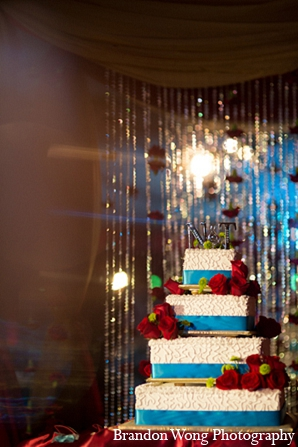 Indian wedding reception cake decor in Newport Beach, California Indian Wedding by Brandon Wong Photography