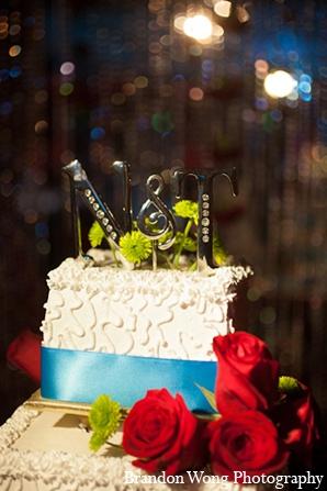 Indian wedding reception decor cake in Newport Beach, California Indian Wedding by Brandon Wong Photography