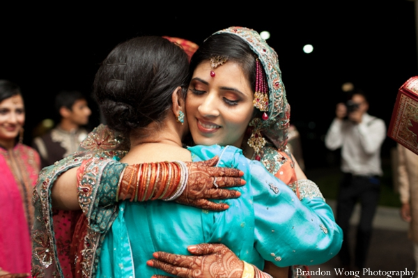 Indian-wedding-pakistani-bride-embrace-reception